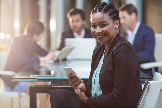 Portrait of businesswoman holding mobile phone in the office